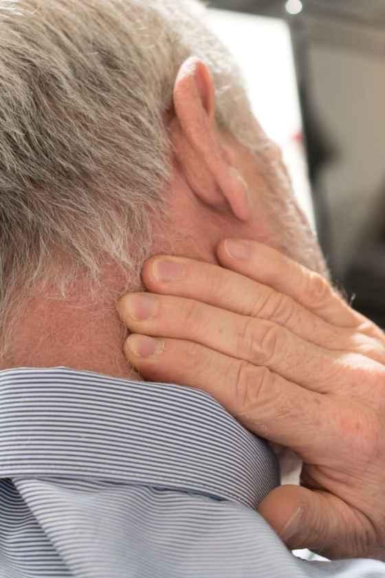 neck pain below ear